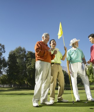 Old and Young Men on a Golf Course Playing Golf