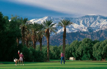 Snow-capped mountains overlook the Furnace Creek Golf Course.