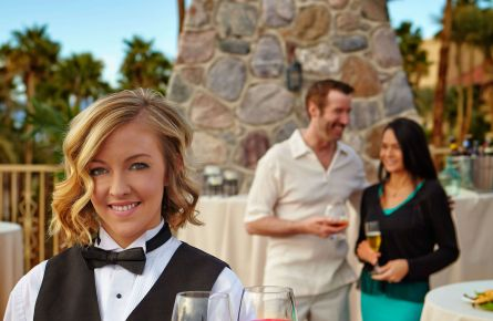 Waitress serving wine at Death Valley